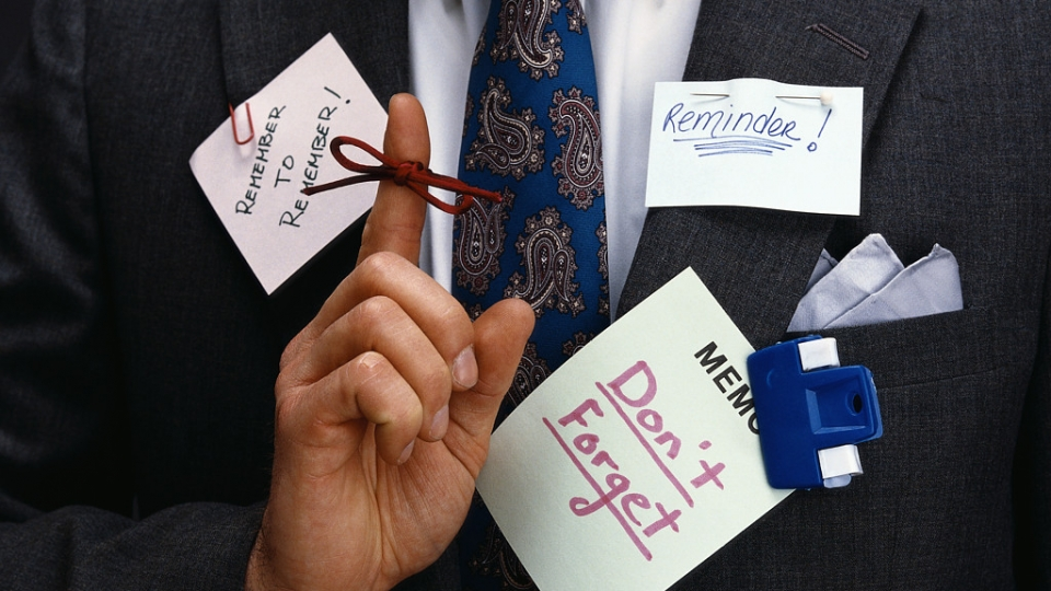 Businessman Wearing Reminders